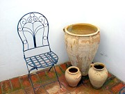 Andalucian pottery and chair From Malaga airport to Casa Granadina