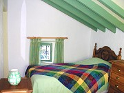 Rural accommodation: Green bedroom Rural accommodation with two bedrooms, Comares, Malaga